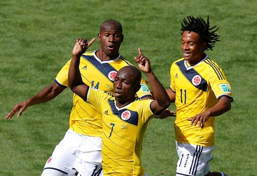 Colombia s Armero celebrates with teammates after scoring a goal during  their 2014 World Cup Group C 18202b9fd67d3